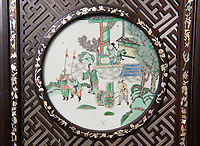 BNPS.co.uk (01202 558833)<br /> Pic: PhilYeomans/BNPS<br /> <br /> Porcelain panels decorate the screen...<br /> <br /> This impressive, giant Chinese screen covered in exquisite porcelain has sold for £75,000.<br /> <br /> The 20ft by 10ft late Qing dynasty-era antique, which can be folded 12 times, would traditionally have been used to divide up large spaces and provide privacy.<br /> <br /> It has hardwood panels bordered by various fruits and flowers with figures of dragons carved into it.<br /> <br /> Attached to the screen are blue and white porcelain plaques showing idyllic landscape scenes.