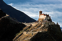 According to legend, Buddhism was received into this shamanistic warring culture by the 28th king of Tibet when Buddhist scriptures fell from the sky onto the roof of the Yumbulagang fortress in the fifth century. Most modern scholars, however, believe that Buddhism was established in Tibet during the reign of King Songtsen Gampo, who died in 650 AD.