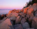 Acadia National Park<br /> Bass Harbor Head Lighthouse (1858) in sunrise light above the rocky point of Mount Desert Island