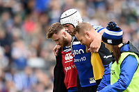 Dave Attwood of Bath Rugby is helped off the field by team-mates Max Wright and Ross Batty. Gallagher Premiership match, between Bath Rugby and Wasps on May 5, 2019 at the Recreation Ground in Bath, England. Photo by: Patrick Khachfe / Onside Images
