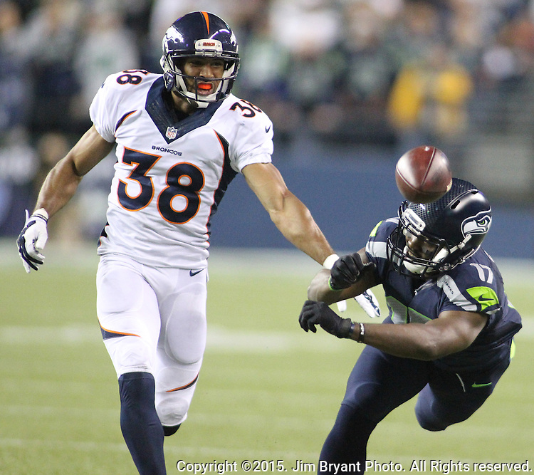 Seattle Seahawks wide receiver Kevin Smith (17) can't haul in a pass against Denver Broncos Curtis Marsh (38) during the third quarter at CenturyLink Field on August 14, 2015 in Seattle Washington.  The Broncos beat the Seahawks 22-20.  © 2015. Jim Bryant Photo. All Rights Reserved.