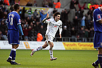 Pictured: Jordi Gomez of Swansea (C) celebrating the goal he scored from a free kick<br />