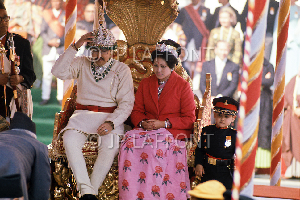 February 24th, 1975. Kathmandu. Nepal. The Coronation of King Birendra and Queen Aishwarya of Nepal, on the chosen day. At 8:37 a.m., the precise moment selected by court astrologers more than a year before, the royal priest placed the huge jewel-encrusted crown on the King's head and a diamond tiara atop Queen Aishwarya's. The King and the Queen just coronated and their young son Dipendra (three and a half years old) who will kill them on June 1 2001.