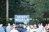 Republican presidential candidate and Wisconsin governor Scott Walker speaks to a small crowd in the backyard of Chris and Diana Ager in Amherst, New Hampshire. The house party was the last stop of a weekend-long motorcycle tour of New Hampshire with periodic campaign stops.
