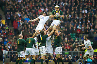 Juandré Kruger of South Africa wins the lineout against Tom Wood of England during the QBE Autumn International match between England and South Africa at Twickenham on Saturday 24 November 2012 (Photo by Rob Munro)
