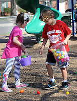 FAIRLESS HILLS, PA - APRIL 12:  Children search for Easter eggs during the YMCA Easter Egg Hunt April 12, 2014 in Fairless Hills Pennsylvania. (Photo by William Thomas Cain/Cain Images)
