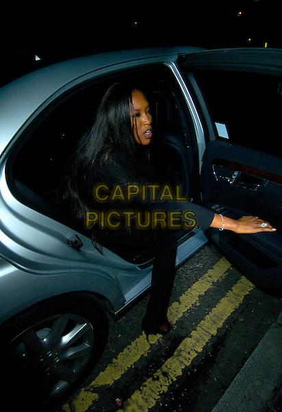 """NAOMI CAMPBELL.""""Swimming With Sharks"""" - gala performance, Vaudeville Theatre, London, England. .October 17th, 2007.full length black trousers jacket bag purse sitting car hand diamond ring funny face .CAP/CAN.©Can Nguyen/Capital Pictures"""