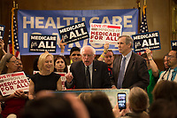 "United States Senator Bernie Sanders (Independent of Vermont), center, announces he has introduced a new version of his ""Medicare for All"" plan at a press conference on Capitol Hill in Washington DC on April 10, 2019.  He is joined by US Senator Kirsten Gillibrand (Democrat of New York), left, and US Senator Edward Markey (Democrat of Massachusetts), right.  The Sanders plan will replace job-based and private health insurance with a government plan that guarantees coverage, including long-term care, for all citizens. Photo Credit: Stefani Reynolds/CNP/AdMedia"