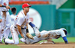 8 September 2011: Los Angeles Dodgers infielder Dee Gordon is caught stealing second on a throw from Washington Nationals catcher Wilson Ramos to second baseman Steve Lombardozzi in the 5th inning at Nationals Park in Washington, DC. The Dodgers defeated the Nationals 7-4 to take the third game of their 4-game series. Mandatory Credit: Ed Wolfstein Photo