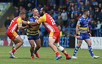 Warrington Wolves' Jason Clark is tackled by Catalans Dragons' Michael McIlorum (left) and Sam Kasiano <br /> <br /> Photographer Stephen White/CameraSport<br /> <br /> Betfred Super League Round 17 - Warrington Wolves v Catalans Dragons - Saturday 8th June 2019 - Halliwell Jones Stadium - Warrington<br /> <br /> World Copyright © 2019 CameraSport. All rights reserved. 43 Linden Ave. Countesthorpe. Leicester. England. LE8 5PG - Tel: +44 (0) 116 277 4147 - admin@camerasport.com - www.camerasport.com