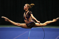 Brenann Stacker of USA split leaps with rope at San Francisco Invitational on February 11, 2006. Stacker placed 3rd in All-Around competition. (Photo by Tom Theobald)