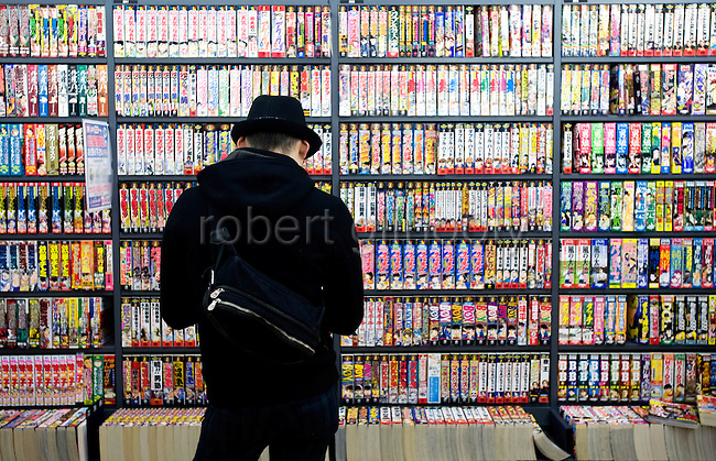 A man looks at a manga in a section of  store containing stories on the theme of child sex in Tokyo, Japan  on 18 Feb. 2010.