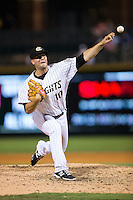 Charlotte Knights relief pitcher Jarrett Casey (10) delivers a pitch to the plate against the Durham Bulls at BB&T BallPark on July 22, 2015 in Charlotte, North Carolina.  The Knights defeated the Bulls 6-4.  (Brian Westerholt/Four Seam Images)