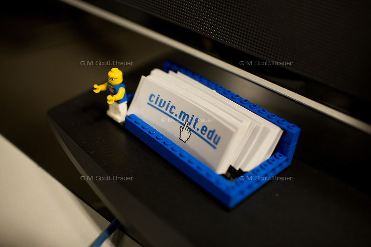 A LEGO block holder displays business cards for the Center for Civic Media at MIT's Media Lab in Cambridge, Massachusetts, USA.