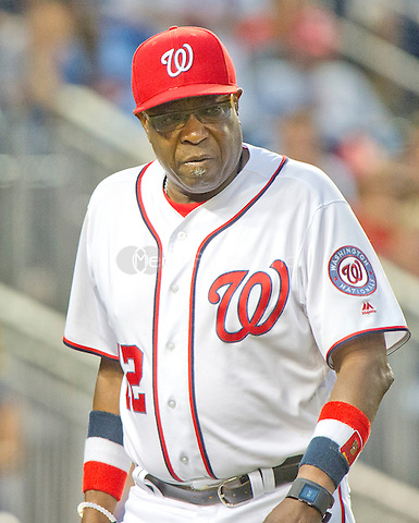 Washington Nationals manager Dusty Baker (12) returns to the dugout after expressing his displeasure with umpire Bob Davidson after Davidson ejected Anthony Rendon from the game for arguing strike calls in the twelfth inning against the Chicago Cubs at Nationals Park in Washington, D.C. on Wednesday, June 15, 2016.  The Nationals won the game 5 - 4 in 12 innings.<br /> Credit: Ron Sachs / CNP/MediaPunch ***FOR EDITORIAL USE ONLY***