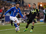 Italy's midfielder Antonio Candreva vies with Spain's forward Thiago during the FIFA friendly football match Spain vs Italy on March 5, 2014 on the eve of their World Cup 2014 at the Vicente Calderon stadium in Madrid.  PHOTOCALL3000 / DP