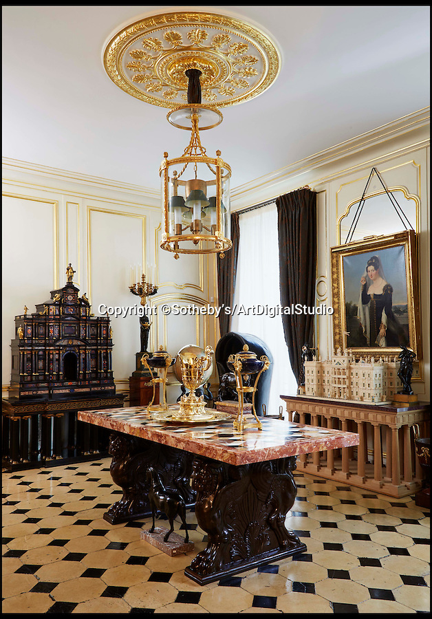 BNPS.co.uk (01202 558833)<br /> Pic: Sotheby's/ArtDigitalStudio/BNPS<br /> <br /> The cabinet in situ.<br /> <br /> An exquisite Roman cabinet made for a 17th century pope that also graced the rooms of Windsor Castle and Buckingham Palace is set to sell for £1.7million.<br /> <br /> The pietre dure piece is the second best example of its type in the world and the only one of the top models made available at public auction.<br /> <br /> The cabinet was made in about 1620 for Pope Paul V Borghese and was later owned by King George IV and Queen Mary before it was sold to a wealthy Hungarian family in 1959.