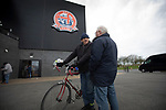 Two home supporters arriving at the stadium before AFC Fylde took on Aldershot Town in a National League game at Mill Farm, Wesham. The fixture was played against the backdrop of the total postponement of all Premier League and EFL football matches due to the the coronavirus outbreak. The home team won the match 1-0 with first-half goal by Danny Philliskirk watched by a crowd of 1668.