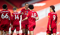 5th July 2020, Anfield, Liverpool, England;  Liverpools Curtis Jones  celebrates after scoring his goal with teammate Virgil van Dijk during the Premier League match between Liverpool and Aston Villa at Anfield in Liverpool