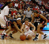 Ohio State Buckeyes guard Cait Craft (13) goes after a loose ball against Tennessee Martin Skyhawks guard Heather Butler (11) and Tennessee Martin Skyhawks forward Ashia Jones (34) on right in the first half at Value City Arena in Columbus Dec. 17, 2013.(Dispatch photo by Eric Albrecht)