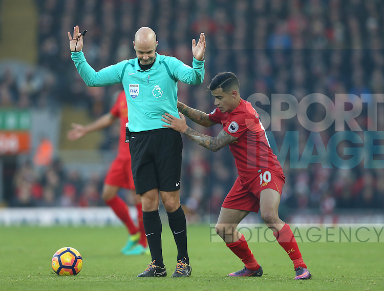 Philippe Coutinho of Liverpool gets stuck behind referee Anthony Taylor during the Premier League match at the Anfield Stadium, Liverpool. Picture date: November 26th, 2016. Pic Simon Bellis/Sportimage