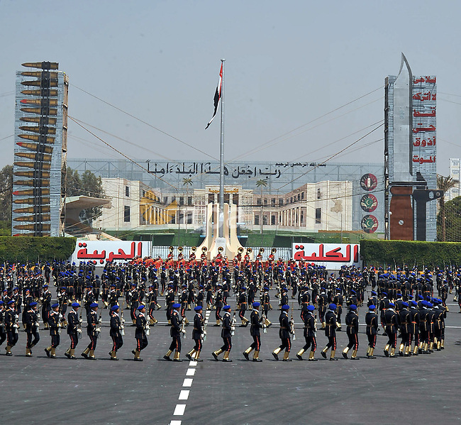 Egyptian troops demonstrate their skills at a graduation ceremony attended by President Mohammed Morsi, unseen, in Cairo, Egypt, Tuesday, July 17, 2012. Egypt's President Mohammed Morsi hailed the Egyptian army and its commanders at a time the newly elected Islamist president and the military council, which took power after ouster of Hosni Mubarak last year, are in mid of power struggle. Sherif Abd Monam / Egyptian Presidency