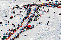 A team runs down the start chute amongst the crowds during the Official Re-Start of the 2018 Iditarod Sled Dog Race in Willow, Alaska on March 04, 2018. <br /> <br /> Photo by Jeff Schultz/SchultzPhoto.com  (C) 2018  ALL RIGHTS RESERVED