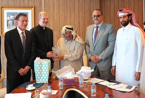 WEB QUALITY ONLY - Ray Whittington, dean of the Driehaus College of Business  and the Rev. Dennis H. Holtschneider, C.M., president of DePaul University, with Sheik Faisal bin Qassim Al Thani, Mr. Tarek El Sayed and Sheik Mohammed bin Faisal (son of Shiekh Faisal). Father Holtschneider presented Sheikh Faisal with a crystal vase engraved with the DePaul logo as university officials visited Sheikh Faisal to present DePaul's proposal for the Center for Entrepreneurship in the Middle East. (DePaul University / GianMario Besana