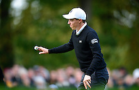 Matthew Fitzpatrick of England acknowledges the crowd on the 17th green during Round 4 of the 2015 British Masters at the Marquess Course, Woburn, in Bedfordshire, England on 11/10/15.<br /> Picture: Richard Martin-Roberts | Golffile