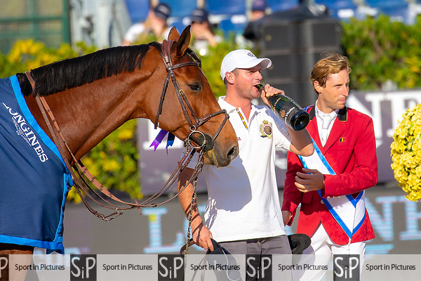 Winners. Team Belgium. Groom with the horse of Pieter Devos swigs champagne. Final Competition Round   Longines FEI Jumping Nations Cup Final. Showjumping. Barcelona. Spain. Day 3. 07/10/2018. ~ MANDATORY Credit Elli Birch/Sportinpictures - NO UNAUTHORISED USE - 07837 394578