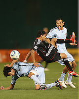 Cristian Castillo #12 of D.C. United crashes into Mehdi Ballouchy #8 of the Colorado Rapids as Pablo Mastroeni #25 yells out during an MLS match on May 15 2010, at RFK Stadium in Washington D.C. Colorado won 1-0.