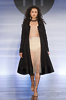 Model walks runway in an outfit by Laurel Preschutti, during the Future of Fashion 2017 runway show at the Fashion Institute of Technology on May 8, 2017.