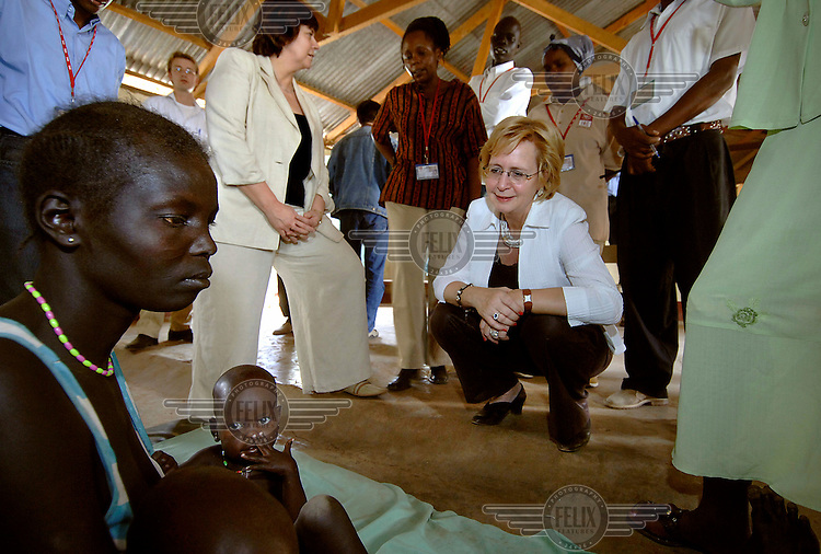 The Dutch Minister for Integration and Immigration, Rita Verdonk (centre right), and the Dutch Minister for Development Cooperation, Agnes van Ardenne (centre left), speak to medical staff at a UNHCR medical clinic near Kakuma refugee camp. Rita Verdonk has been involved in campaigns to keep and protect refugees in their homelands in an attempt to reduce migration to Europe..
