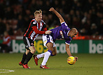 Mark Duffy of Sheffield Utd and Karl Henry of Bolton Wanderers during the Championship match at Bramall Lane Stadium, Sheffield. Picture date 30th December 2017. Picture credit should read: Simon Bellis/Sportimage