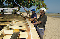 Carpenters working on a fishing boat
