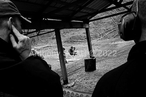 Machine Gun Shoot<br /> Knob Creek<br /> Westpoint, Kentucky<br /> USA<br /> April 3, 2009<br /> <br /> Nearly 16,000 people attend the Knob Creek Machine Gun Shoot &amp; Military Gun Show. It is the largest gathering of Civilian owned machine guns in the world. The gun show has over 700 tables with machine guns, military surplus, ammo, hard to find parts &amp; pieces and regular firearms and supplies.<br /> <br /> Firearms sales have surged in the six months since Obama's election as millions of Americans have gone on a buying spree that has stripped gun shops in some parts of the country almost bare of assault weapons and led to a national ammunition shortage.<br /> <br /> The FBI says that since November more than seven million people applied for criminal background checks in order to buy weapons, a figure excluding the many more buying at thousands of gun shows in states such as Virginia, without facing any checks.<br /> <br /> Gun-shop owners and the National Rifle Association say the surge is driven by worries that Obama is planning to ban many types of firearms and that the deepening economic crisis will fuel a crime wave, as witnessed by the string of mass shootings in the past few weeks.<br /> <br /> But control groups pressing for greater control on firearms accuse the NRA of funding a massive scare campaign to portray Obama as a gun owner's worst nightmare and to argue that tighter restrictions on weapons ownership are a threat to broader liberties and a step toward tyranny.