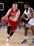 SIOUX FALLS, SD - MARCH 5:  Logan Power #33 of South Dakota dribbles past Charles Ruise, Jr. #5 of Fort Wayne in the 2016 Summit League Tournament.  (Photo by Dave Eggen/Inertia)