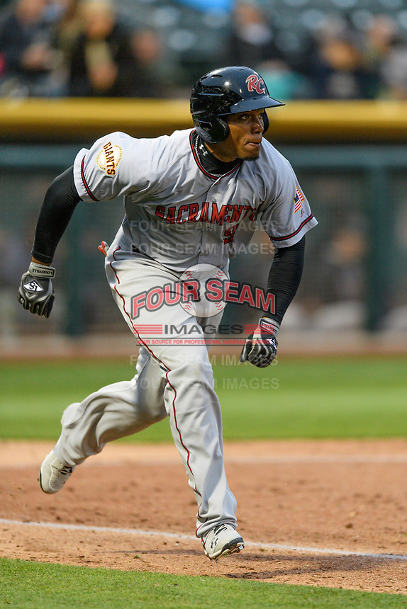 Carlos Moncrief (9) of the Sacramento River Cats hustles down the first base line against the Salt Lake Bees during the Pacific Coast League game at Smith's Ballpark on August 11, 2017 in Salt Lake City, Utah.The River Cats defeated the Bees 8-7. The River Cats defeated the Bees 8-7. (Stephen Smith/Four Seam Images)