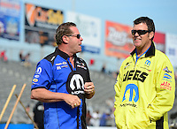 Sept. 30, 2012; Madison, IL, USA: NHRA pro stock driver Allen Johnson (left) with Jeg Coughlin Jr during the Midwest Nationals at Gateway Motorsports Park. Mandatory Credit: Mark J. Rebilas-
