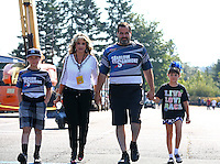 Aug. 3, 2014; Kent, WA, USA; NHRA pro stock driver Chris McGaha with his wife and children during the Northwest Nationals at Pacific Raceways. Mandatory Credit: Mark J. Rebilas-