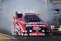 Feb. 22, 2013; Chandler, AZ, USA; NHRA funny car driver Courtney Force during qualifying for the Arizona Nationals at Firebird International Raceway. Mandatory Credit: Mark J. Rebilas-