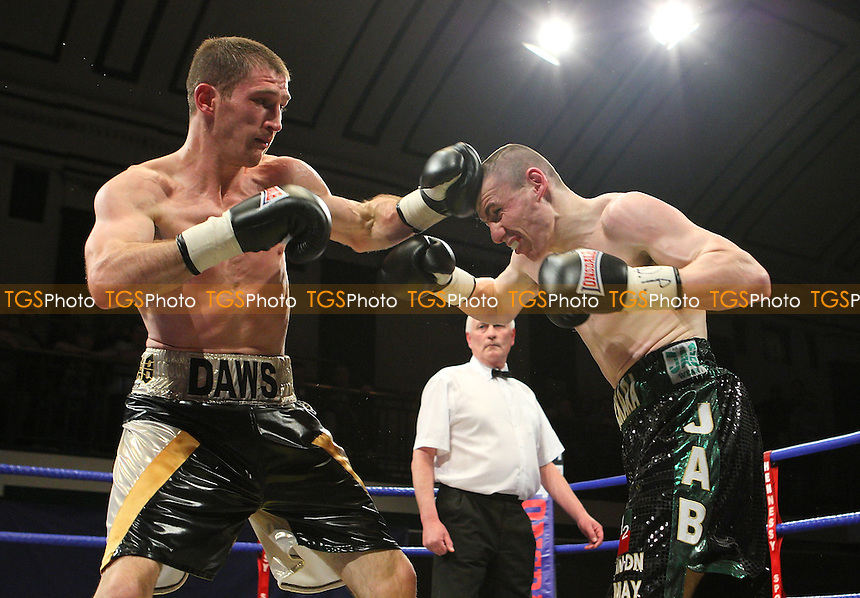 Lenny Daws (Morden, black/white/gold shorts) defeats Peter McDonagh (Bermondsey, black/green shorts) in a LightWelterweight boxing contest for the English Title at York Hall, Bethnal Green, London, promoted by Hennessy Sports -  11/04/09 - MANDATORY CREDIT: Gavin Ellis/TGSPHOTO - Self billing applies where appropriate - Tel: 0845 094 6026
