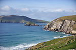 19-2-2012: Surfers skim the waves off Coomeenole Beach in West Kerry on Sunday in pleasant Spring sunshine..Picture by Don MacMonagle