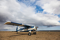 Coyote Air de Havilland Beaver bush plane lands on a ridge in Alaska's Arctic.