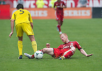 July 27, 2013: Toronto FC defender Richard Eckersley #27 and Columbus Crew defender/midfielder Danny O'Rourke #5 in action during an MLS regular season game between the Columbus Crew and Toronto FC at BMO Field in Toronto, Ontario Canada.<br /> Toronto FC won 2-1.
