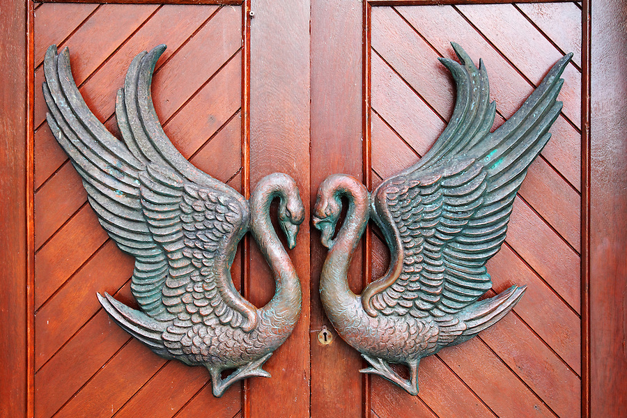 Swan figures on red doorway to St. Columba's Church, Drumcliffe, County Sligo, Republic of Ireland