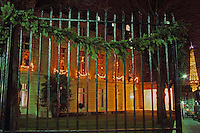 The exterior, behind bars, a fence and the Eiffel Tower to the right. The Baccarat museum, shop, restaurant at the Hotel de Noailles in Paris. Designed by Philippe Starck.