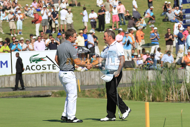 Damien McGrane shakes hands with Luke Donald on the 18th on the final day of the Alstom Open de France at .Golf National St Quentin en Yvelines, Paris France, 4/7/10..Picture Fran Caffrey/www.golffile.ie
