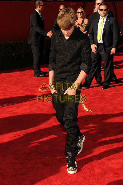 Justin Bieber.2011 ESPY Awards - Arrivals held at Nokia Theatre L.A. Live, Los Angeles, California, USA..July 13th, 2011.full length black shirt jeans denim hands in pockets looking down.CAP/ADM/BP.©Byron Purvis/AdMedia/Capital Pictures.