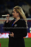 Cardiff City Stadium, Friday 11th Oct 2013. Carrie Thompson of Swansea sings the Welsh National anthem during the Wales v Macedonia FIFA World Cup 2014 Qualifier match at Cardiff City Stadium, Cardiff, Friday 11th Oct 2014. All images are the copyright of Jeff Thomas Photography-07837 386244-www.jaypics.photoshelter.com